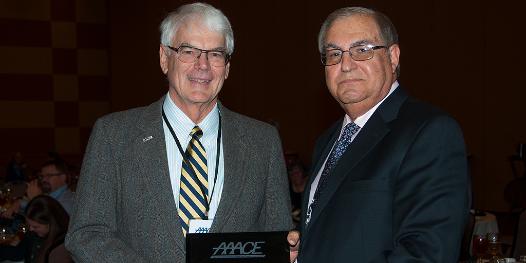 Jim Pappas accepts award from AAACE