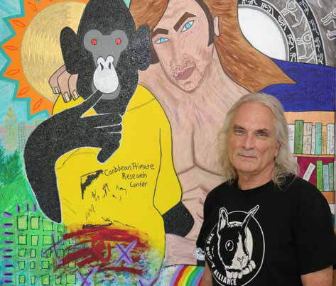 Bob Ingersoll with a painting of Nim by Tulsa artist Lauren Lunsford