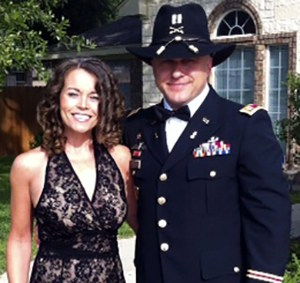 Military spouse Michelle Wilson posing with her husband