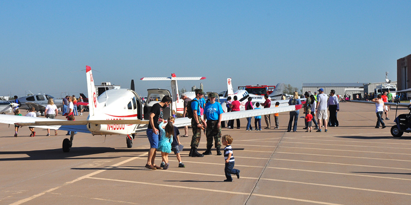 Children and adults at the Regional Fly-in hosted by OU Aviation