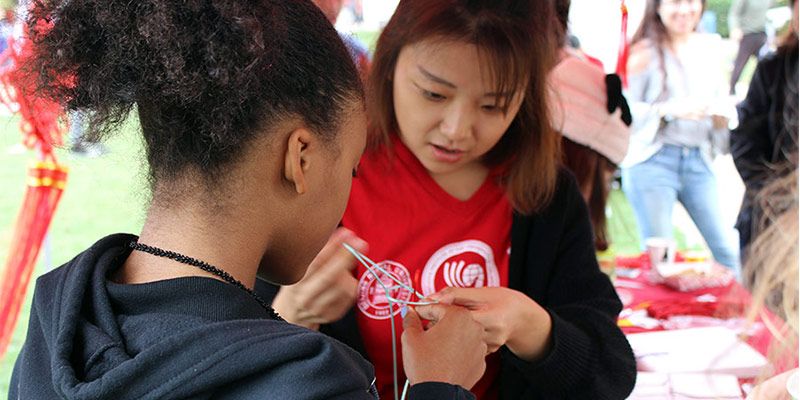 Tying knots at the Chinese Culture Festival during Confucius Institute Day