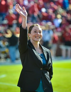 Kimberly Mahoney being recognized on field at the Gaylord Family Memorial Stadium