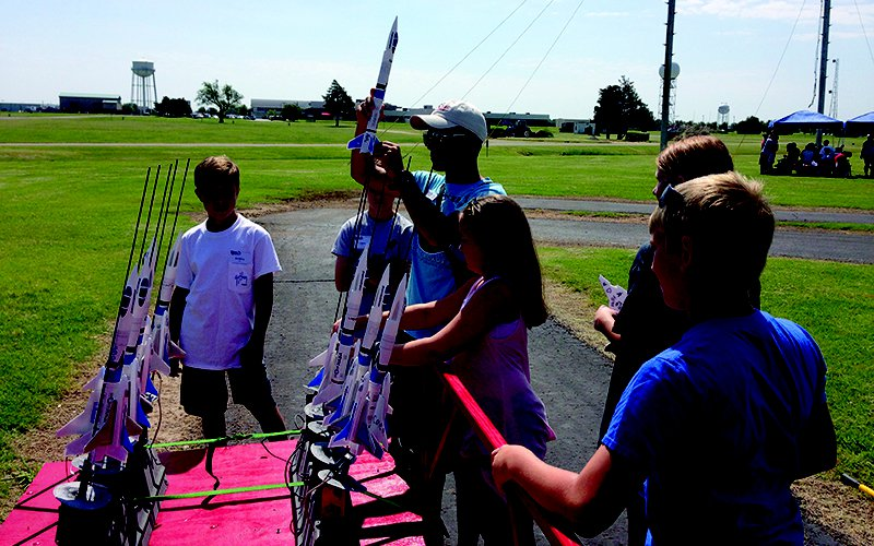 Filed trip students learning about rockets