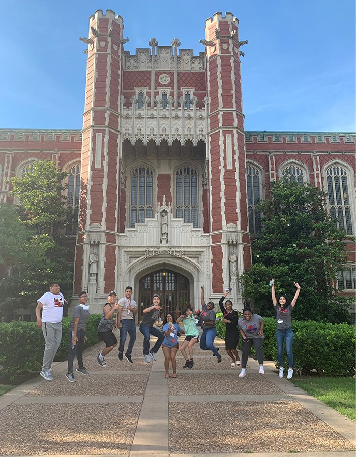 summer camp students in front of Bizzell library