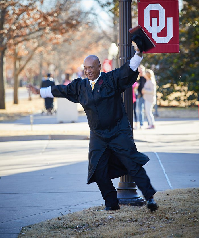 OU Extended Campus graduate celebrating